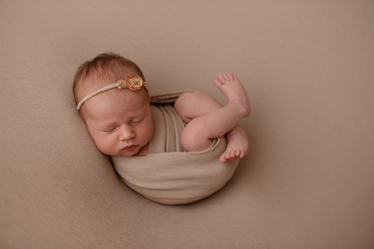 Baby girls newborn portraits on a brown backdrop at a photography studio in queens new york